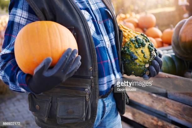 Farmer with pumpkin and squash