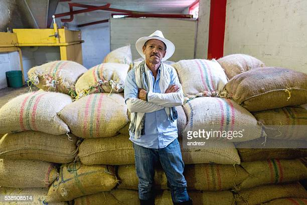 Farmer with sacks of Colombian coffee