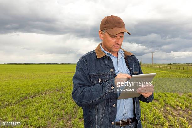 Farmer with Tablet Computer