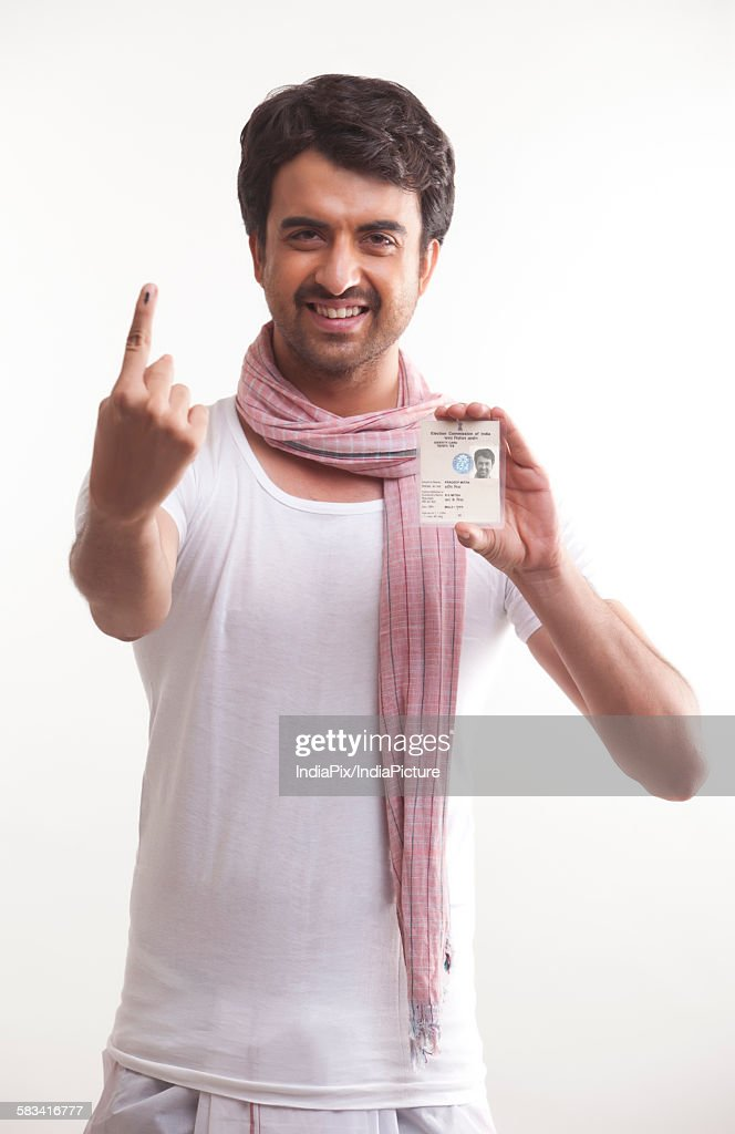 Farmer with voters mark and identity card : Stock Photo