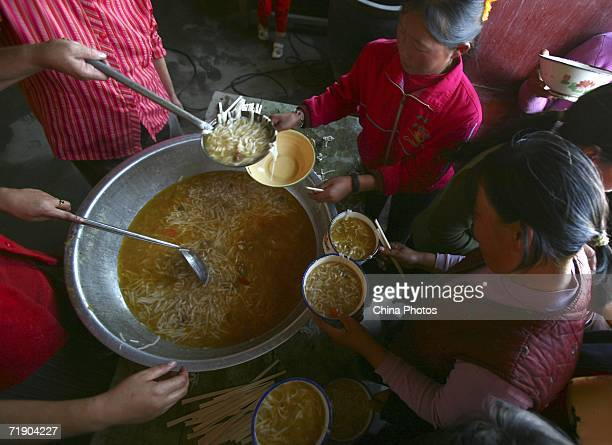 Farmer workers from Gansu Province get lunch on September 14 2006 in Hami of Xinjiang Uygur Autonomous Region China About one million farmer workers...