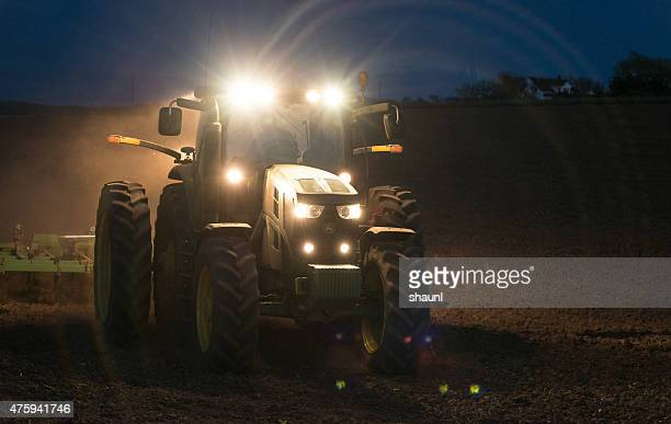 farmer working late - john deere tractor stock photos and pictures