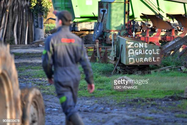 A farmer works in La Vache rit a farm in the 'Zad' of NotreDamedesLandes on January 17 2018 in NotreDamedesLandes outside Nantes The 'Zad' of...