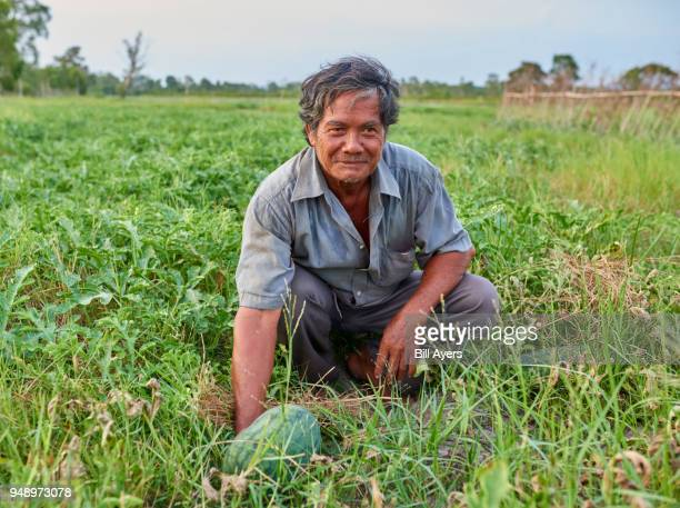 A farmer works with his crops
