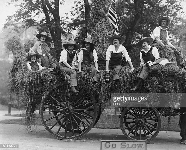 'Farmerettes' help collect funds to supply milk for babies in France during World War I circa 1918 From left to right Mable Standley Helen Gates Mary...