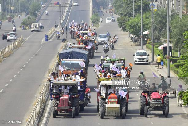 Farmers aboard tractors arrive for Punjab bandh, a statewide farmers' strike against the passing of agriculture reform bills in the Parliament, at...