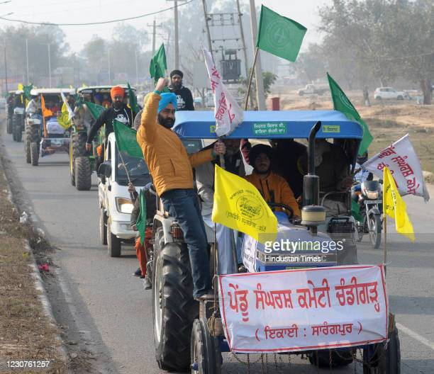 Farmers and their family members participate in a tractor rally against the new farm laws, at Dhanas village, on January 23, 2021 in Chandigarh,...
