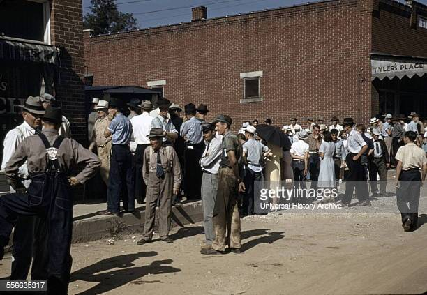 Farmers and townspeople in the centre of town on Court Day, Campton, Kentucky by photographer Marion Post, Wolcott . September 1940.
