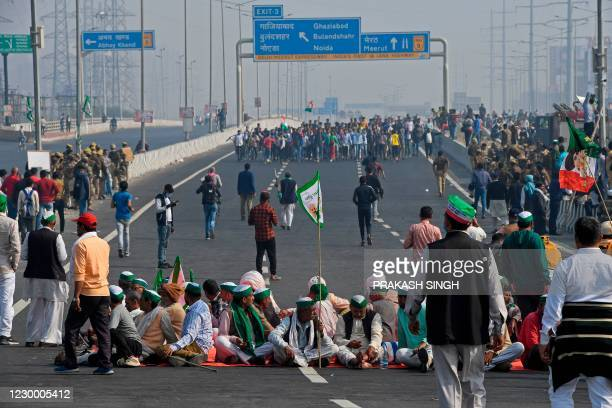 Farmers block a highway during a nationwide general strike called to protest against the recent agricultural reforms at the Delhi-Uttar Pradesh state...