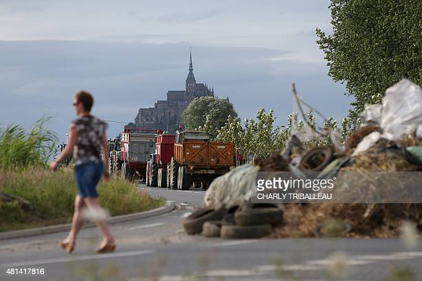 Farmers block a road during a protest near Mont SaintMichel in northwestern France on July 20 2015 Hundreds of angry French farmers blocked roads...