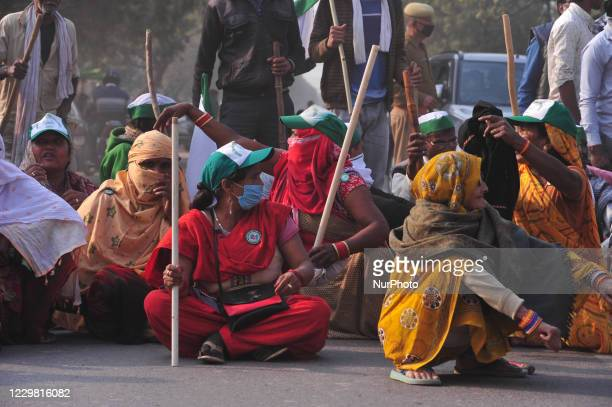 Farmers block national highway 2 to protest against the central government's recent agricultural reforms at the outskirts of Allahabad in November...