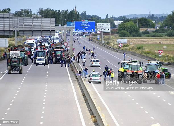Farmers block the A31 highway in Hauconcourt eastern France during a demonstration against falling food prices which they blame on foreign...