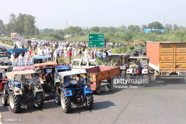Farmers blocking a stretch along NH9 connecting Rohtak to Hisar, in protest against two agriculture related bills that were cleared today by the...