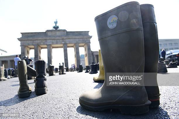 Farmers' boots are seen in front of the Brandenburg Gate in Berlin during a protest action of milk farmers association on May 30 2016 German...