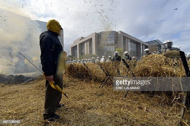 Farmers clash with riot police during a demonstration of European farmers in Brussels on September 7 as an extraordinary European agriculture council...