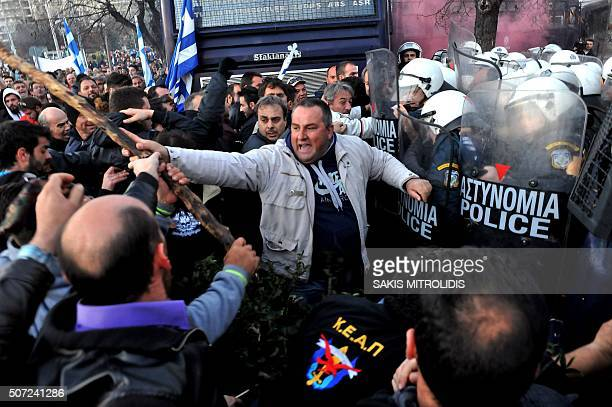 TOPSHOT Farmers clashes with Greek antiriot police officers during a protest against a controversial pension reform that is part of the country's...
