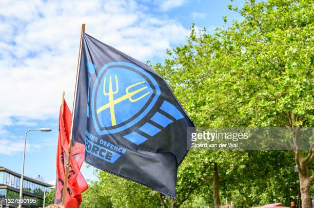 Farmers Defense Force flag during a protest where farmers are parking their tractors on the side of the street in front of the Zwolle office of the...