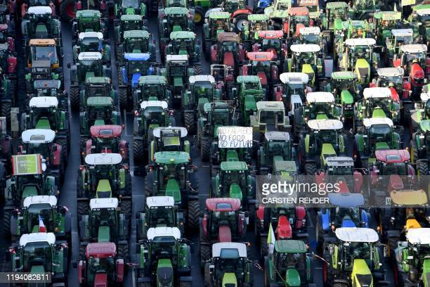 Farmers demonstrate on their tractors to protest against the government's agricultural policy on the sidelines of the 94th International Green Week...