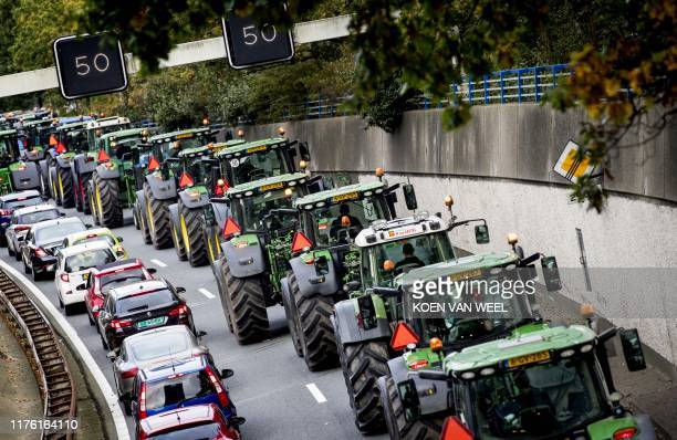 Farmers drive their tractors in a line in The Hague on October 16 2019 during a protest against the nitrogen policy rules / Netherlands OUT