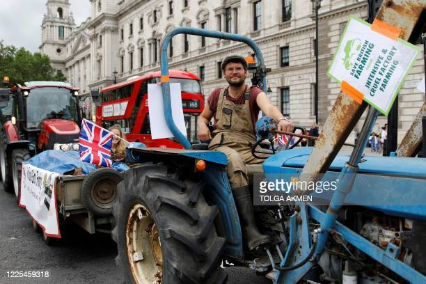 Farmers drive tractors around Parliament square in central London as they protest against sub-standard imports that could threaten their livelihoods...