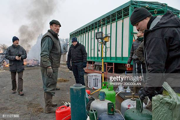 Farmers free accesses to the Leclerc's Scacentre logistic platform at Yzeure on February 18 after several days of blocking French farmers have...