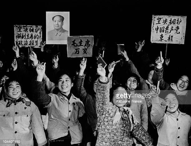 Farmers from the Chiangtai commune near Beijing and new Communist Party members acclaiming the new Party constitution and waving MAO'S LITTLE RED...
