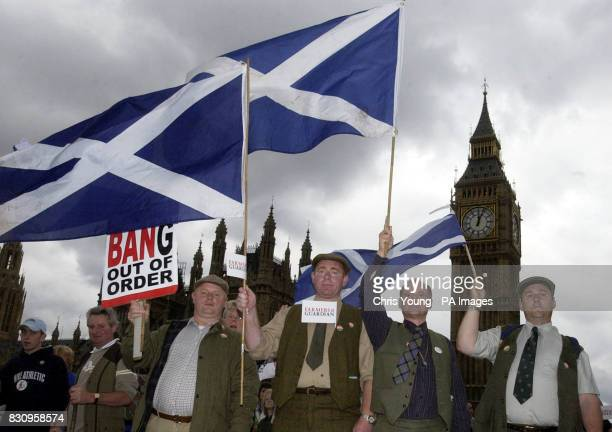 Farmers from West Lothian holding sign and flags James Haggarty Tom Curry Peter Chambers and John Pate stand proudly on Westminster Bridge at the...