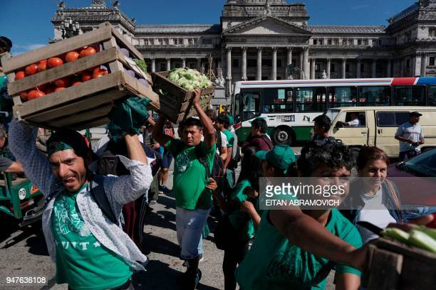 Farmers give away 30 tonnes of vegetables in front of the National Congress in Buenos Aires on April 17 2018 demanding that a law they presented two...