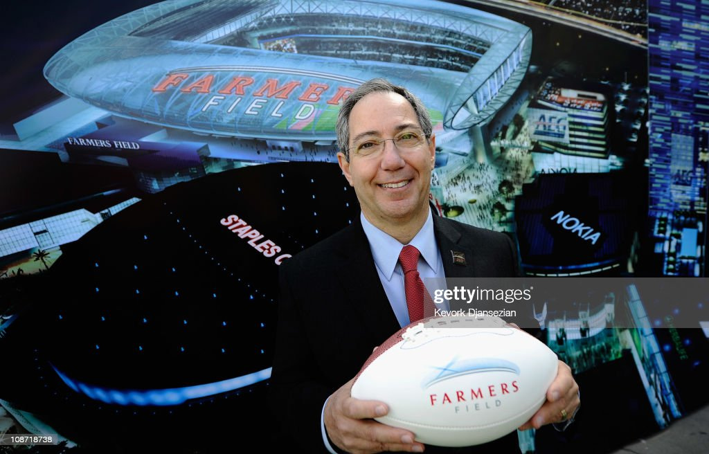 Farmers Insurance Exchange executives Paul Patsis holds a football after an event announcing naming rights for the new football stadium Farmers Field at Los Angeles Convention Center on February 1, 2011 in Los Angeles, California. AEG has reportedly sold the naming rights for the proposed stadium to Farmers Insurance Exchange for $650,000, calling the stadium 'Farmers Field.'