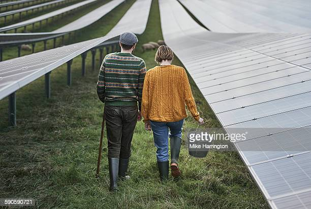 farmers maintaining their solar farm - wellington boot stock pictures, royalty-free photos & images