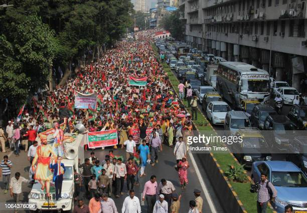Farmers march heading towards Azad Maidan from Lalbaug area, demanding better compensation for drought and transfer of Forest rights to tribals, on...