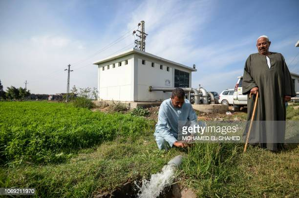 Farmers observe water pumping in Kafr alDawar village in northern Egypt's Nile Delta on November 26 2018 The country's agricultural heartland and its...