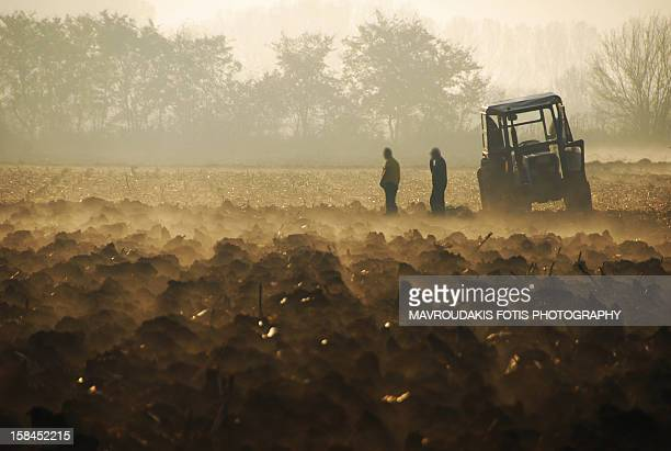 Farmers on a freshly plowed field
