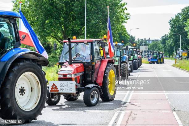 Farmers parking their tractors on the side of the street in front of the Zwolle office of the Overijssel province in The Netherlands to protest...
