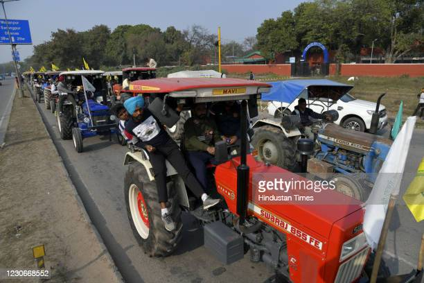 Farmers participate in a Tractor Rally at sector 25/38 dividing road against the new farm laws, on January 18, 2021 in Chandigarh, India.