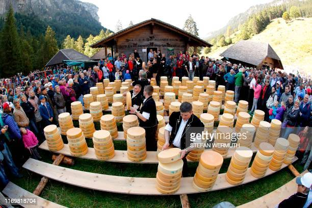 TOPSHOT Farmers pile up pieces of cheese during the traditional Chaesteilet in Justistal 40kms south of Bern Switzerland on September 20 2019 Every...