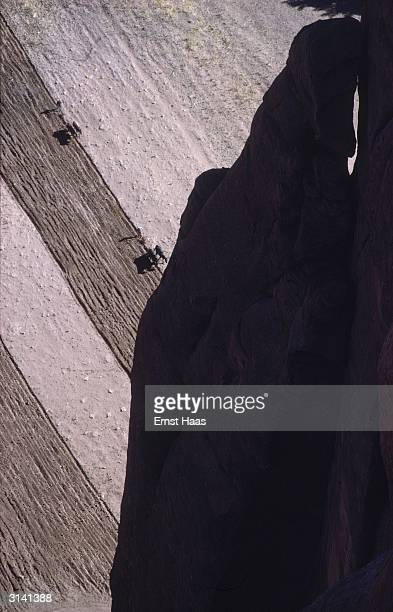 Farmers ploughing the land beneath the Canyon de Chelly in Arizona Colour Photography book