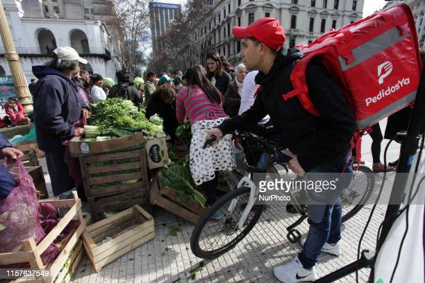 Farmers protest selling what they produce at low prices without intermediaries to people who gathered in Plaza de Mayo Buenos Aries Argentina on 24...