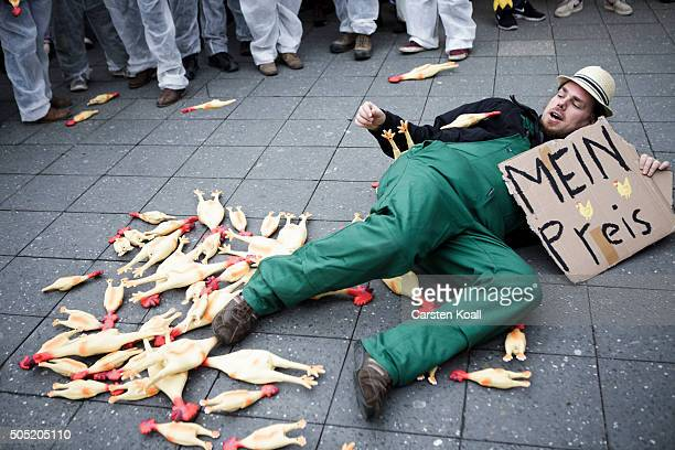 Farmers protesting making a performance against corporate agriculture as well as the pending TTIP free trade agreement between the European Union and...