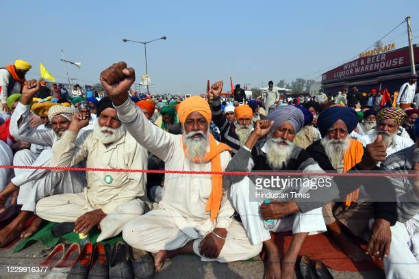 Farmers raise slogans during a protest over farm reform laws at Singhu Border, on December 2, 2020 in New Delhi, India. Farmers from Punjab and...