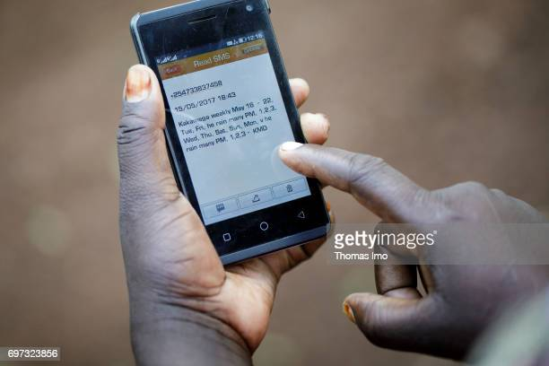 Farmers receive via SMS message on the phone information about the weather Bukura Agricultural Training Center in Kakamega County on May 16 2017 in...