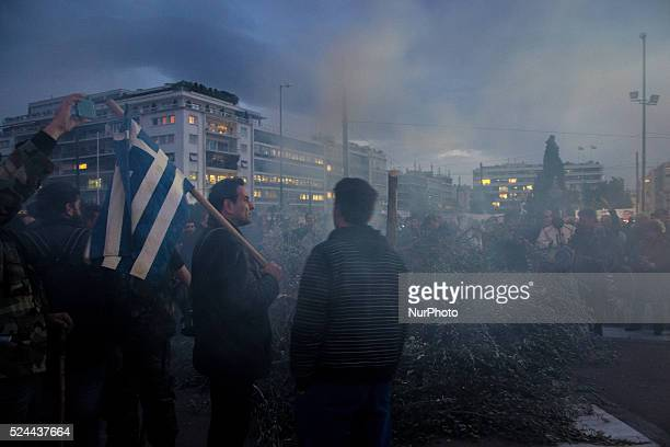 Farmers set fire in front of the Parliament building at Syntagma Square during a protest against pension reform Greek farmers from across the country...