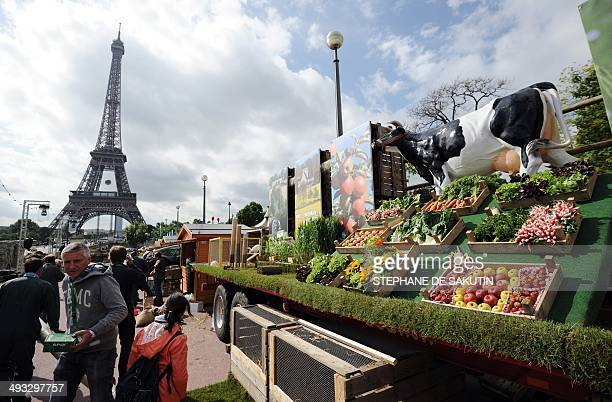 Farmers set up an organic street market on May 23 2014 in front of the Eiffel Tower in Paris prior to the launch of '' the Green night '' an event on...