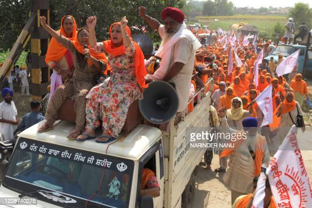 Farmers shout slogans as they arrive to block railway tracks during a protest against Indian Prime Minister Narendra Modi's government following the...