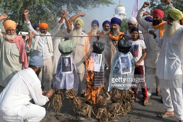 Farmers shout slogans as they burn effigiesof India's Prime Minister Narendra Modi , Union Agriculture Minister Narendra Singh Tomar and Bollywood...