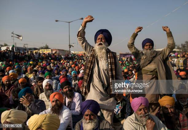 Farmers shout slogans as they participate in a protest at the Delhi Singhu border on December 18, 2020 in Delhi, India. Hundreds of thousands of...