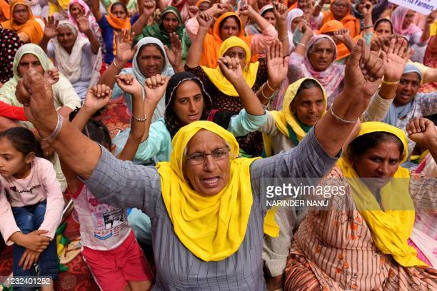Farmers shout slogans as they take part in a protest against the central government's recent agricultural reforms on the outskirts of Amritsar on...
