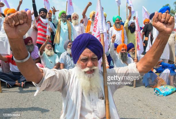 Farmers shout slogans during a demonstration to protest against the government in Beas on September 14, 2020.