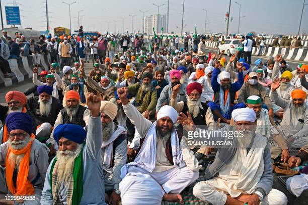 Farmers shout slogans during a protest against the central governments recent agricultural reforms at the Delhi-Uttar Pradesh state border in...