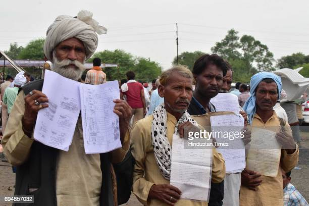 Farmers showing their applications handed over to Madhya Pradesh Chief Minister Shivraj Singh Chouhan during his indefinite fast on June 11 2017 in...